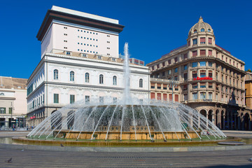 Panoramic view of De Ferrari square in Genoa, the heart of the city with the central fountain