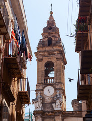 Ancient bell tower in the center of Palermo, Italy.