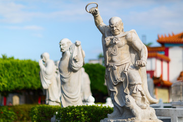 Stone statues at the Da Fo Buddhist Temple. Chung Cheng Park. Keelung