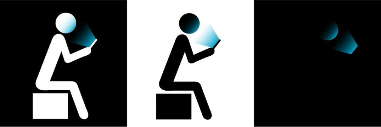 Man holding smartphone with face illuminated