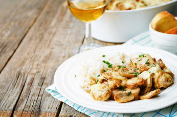 chicken baked with mushrooms and cheese with rice