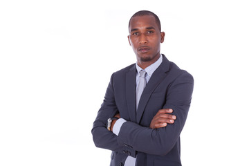 Unhappy African american business man with folded arms over whit