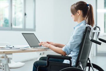 Young disabled businesswoman at work