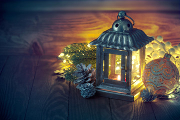 Christmas lantern with fir and tinsel