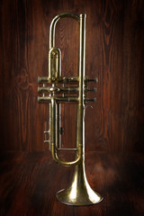 Silver trumpet on wooden background
