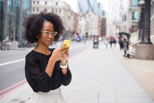 young woman sending a text message