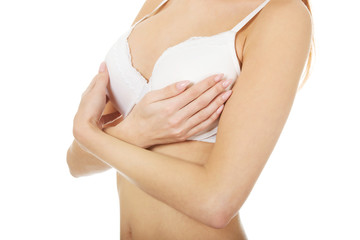 Woman breast in white bra.