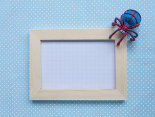 Wood frame with red and blue spider on blue background
