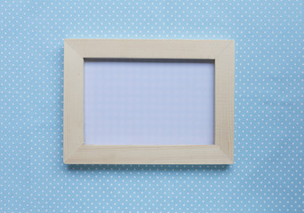 Wood picture frame on blue background