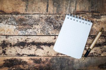 white notebook on grunge wood