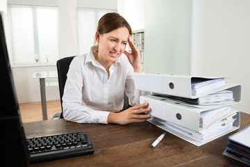 Young Businesswoman Looking At Folders