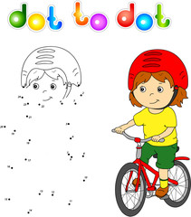 Young boy riding a bicycle in helmet