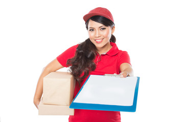 Female delivery service happily delivering package to costumer