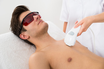 Worker Giving Man Laser Epilation