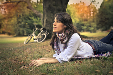 Woman lying on the grass at the park