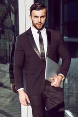portrait handsome businessman in urban setting