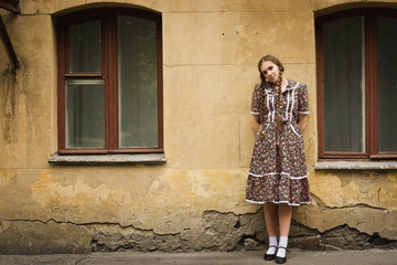 Soviet girl in retro style is on the Moscow street