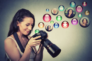 happy woman with camera models social media icons flying out of screen