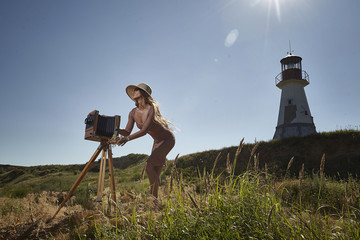 Model with a camera with a view of the lighthouse.