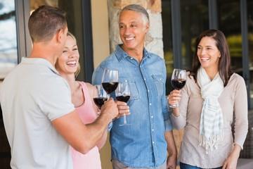 Happy friends in a wine tasting having wine