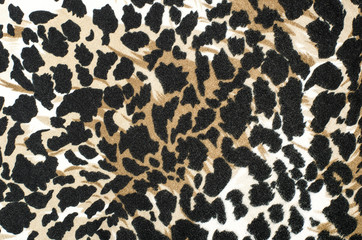 Brown and black leopard fur pattern. Spotted animal print as background.