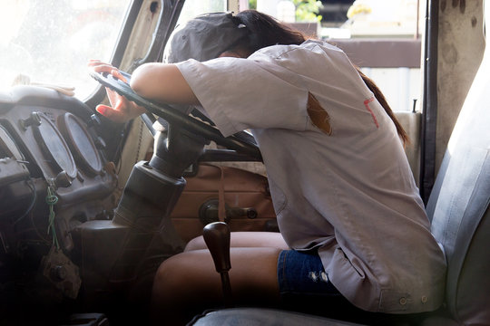 woman lying on the steering wheel of the truck