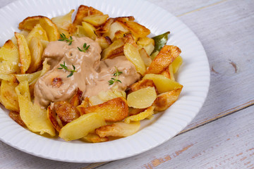 Chicken breasts in mushroom creamy sauce and home fried potatoes