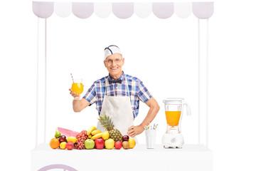Mature soda jerk holding a glass of orange juice