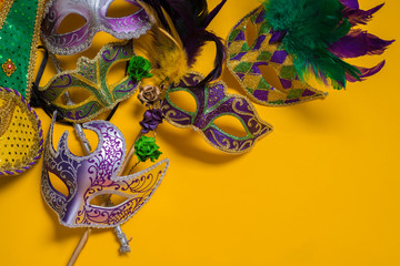 Wall Mural - Mardi Gras Mask on yellow Background