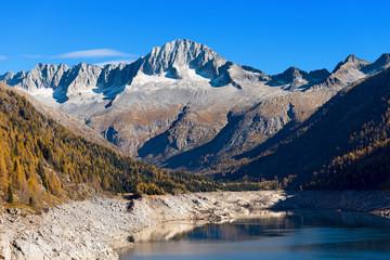 Care Alto and Bissina Lake - Trentino Italy / Peak of Care Alto (3462 m) and Lake of Malga Bissina in the National Park of Adamello Brenta. Trentino Alto Adige, Italy
