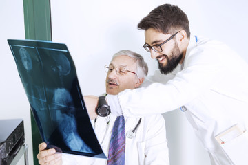 doctors examining an X-ray of a woman's body