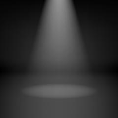 Empty dark room with spotlight