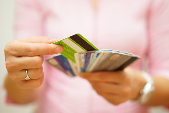 woman choose one credit card from many, concept of  credit card