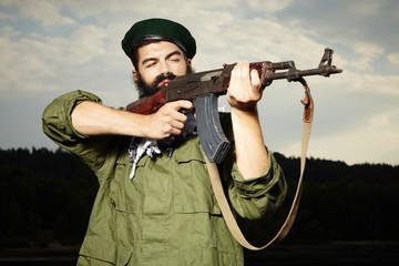 Volunteer with AK-47 handgun