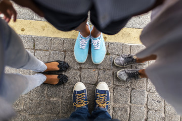 Feet and shoes. Selfie image taken from above.