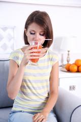 Young beautiful woman drinking fresh juice