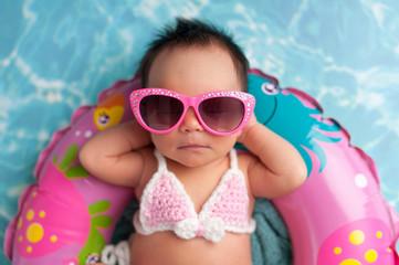 Newborn Baby Girl Wearing Sunglasses and a Bikini Top