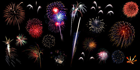 Colorful holiday fireworks on the black sky background