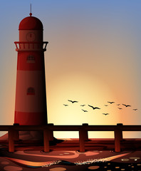 Silhouette lighthouse by the ocean