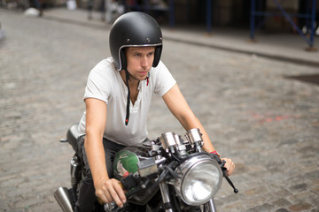 A caucasian man riding motorcycle