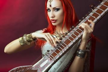 Beautiful Redhead Woman in Indian Sari with Oriental Jewelry Pla