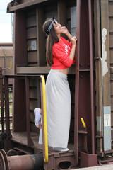 girl posing train station
