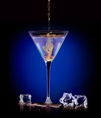 Exotic Spirit Drink. Pouring a mixer into a martini