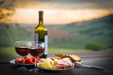 Fototapeta still life Red wine  ,cheese and prosciutto