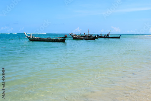 Long Tail Boats Moored At Nai Yang Beach Et Thailand With Blue Sky Background