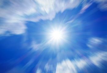 Blurred image of blue-sky with sun for background use