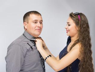 woman man tie a tie