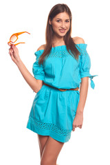 Pretty girl in blue dress with glasses isolate on white backgroun