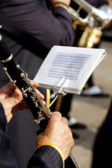 Playing a clarinet. View of the score of a man playing a clarinet .