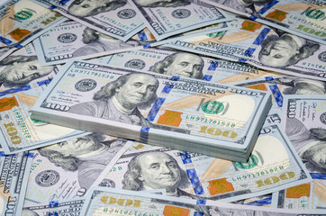 One hundred dollars bills paper money background